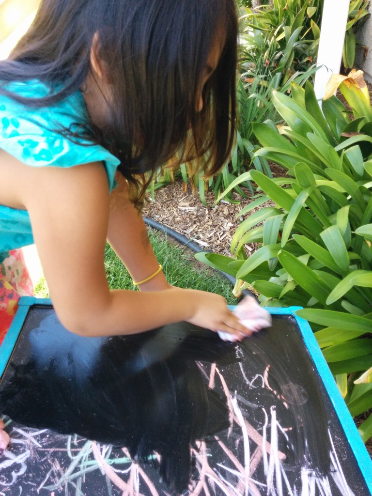 alana cleaning chalkboard table