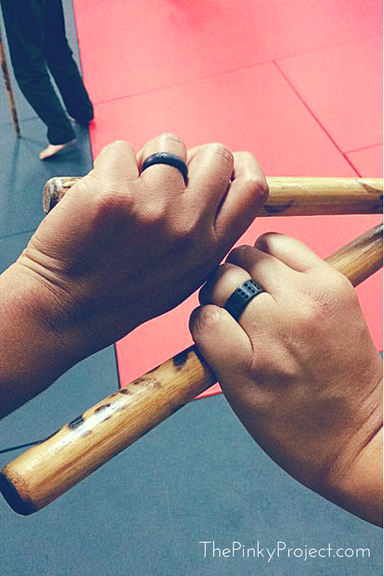 holding-sticks-and-rings